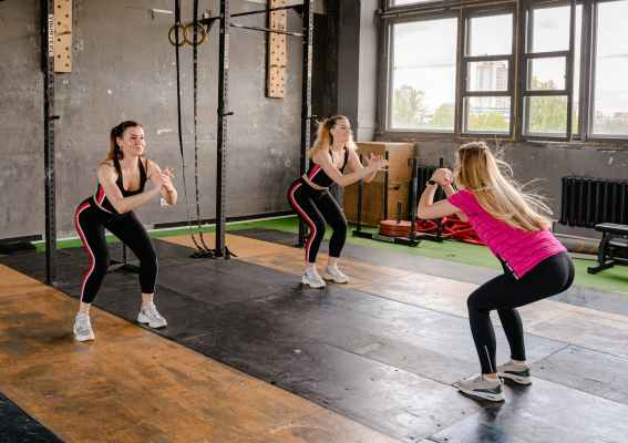photo of women doing squats