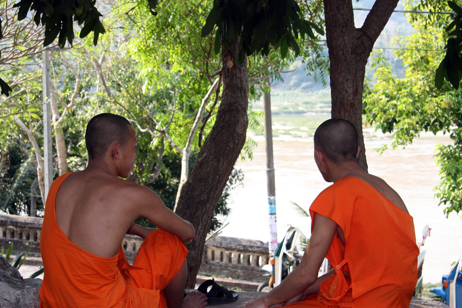 Two Monks relaxing by the river