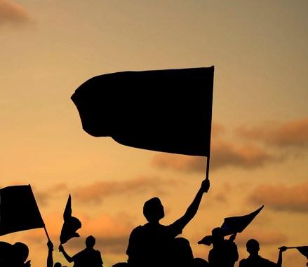 silhouette of protestors