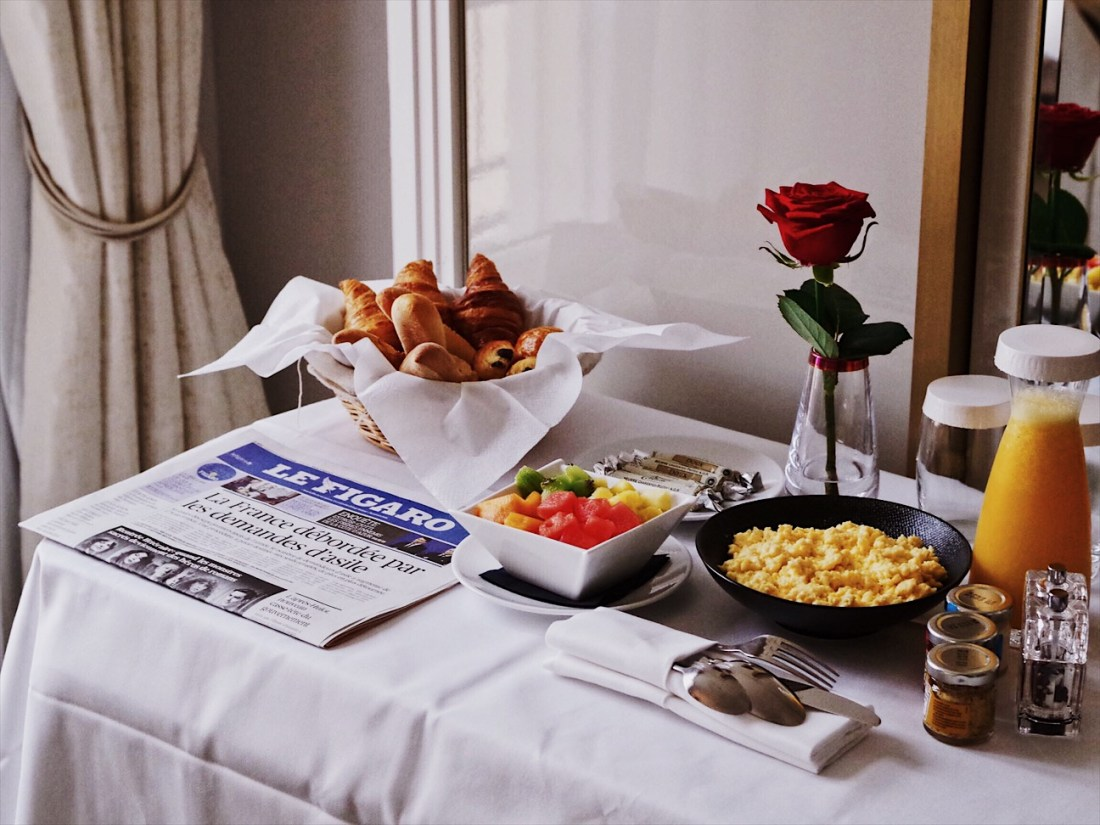 french newspaper breakfast in bed hotel