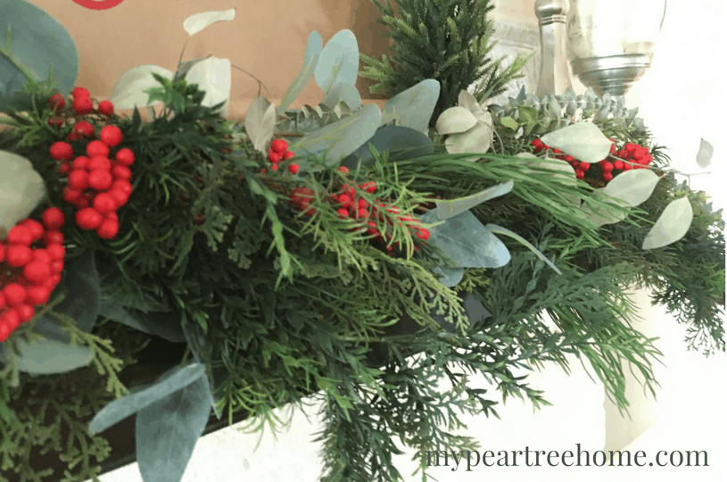 Want an easy way to add a dramatic look to your mantle and spend practically NOTHING? Yep, we all do! Click to the post to see how to make a DIY scroll and also my secret tip for decorating a mantle!