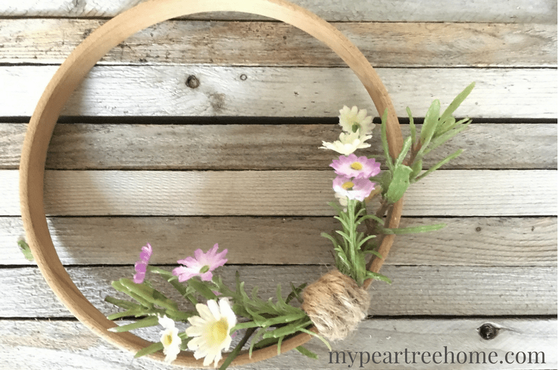 This has to be hands down the EASIEST wreath you will ever make! Click to the post to find out how to make this super cute and on-trend embroidery hoop wreath!