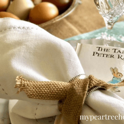 I love the idea of using Beatrix Potter books as place setting decor for Easter!