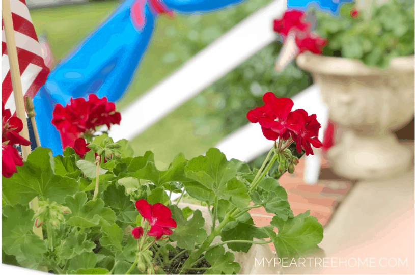 Use items from Dollar Tree to create your own DIY patriotic bunting for your porch this 4th of July