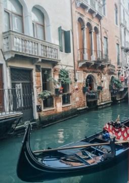 Riding on a gondola in Venice, Italy
