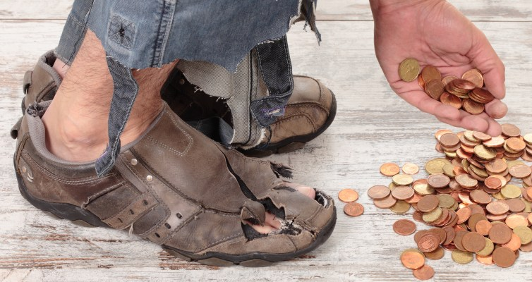 feet + hands of homeless man picking up coins. has no voice
