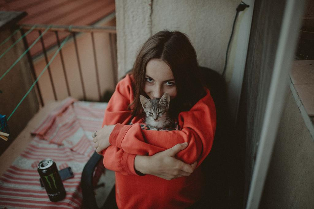 Image of a cat cuddling to her human in the blog Understanding your cat's body language