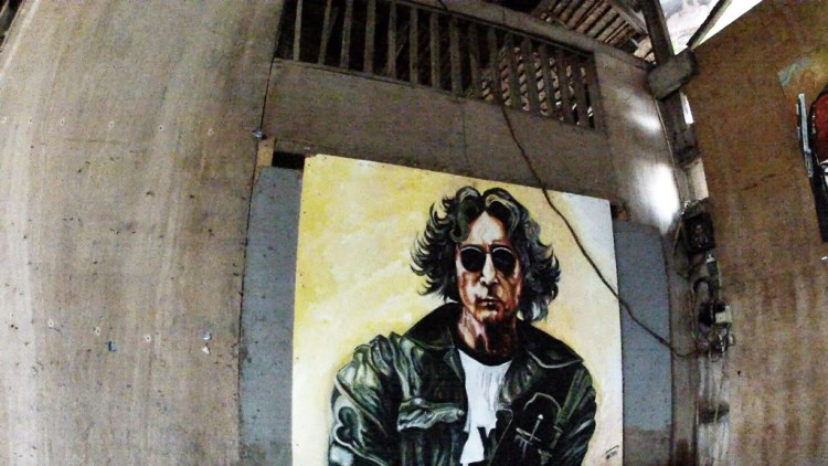 Oslob Jon Lennon painted on carrendaria wall
