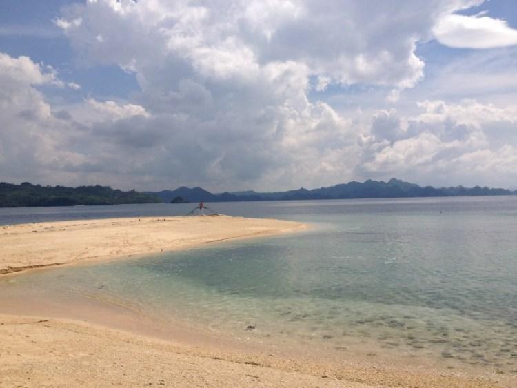 Sip white sand beach