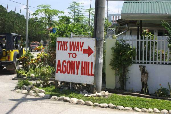 "A sign marks the way to ""Agony Hill"""