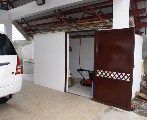 Tiled garage floor and storage room