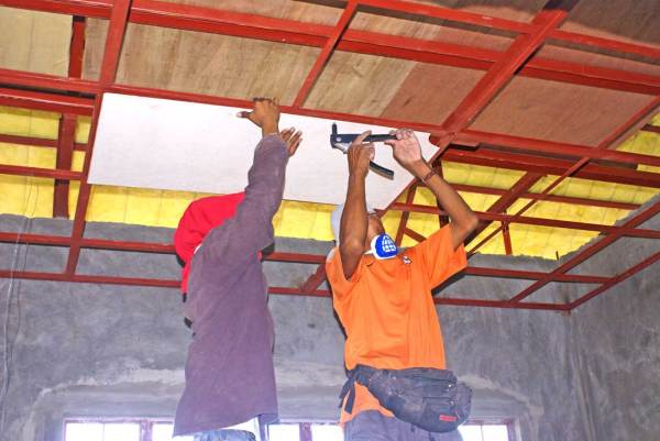 Riveting Hardiflex panels to steel ceiling structure