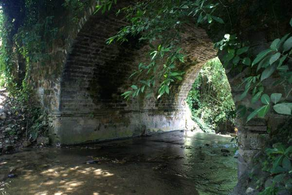 Underneath the modern highway lurks a rare Spanish stone bridge