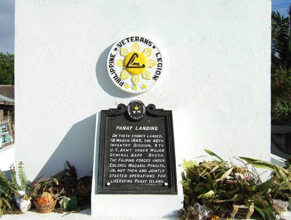 The old historical plaque was used on the rebuilt memorial.