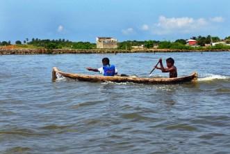 Native boys paddling around Boca Grande