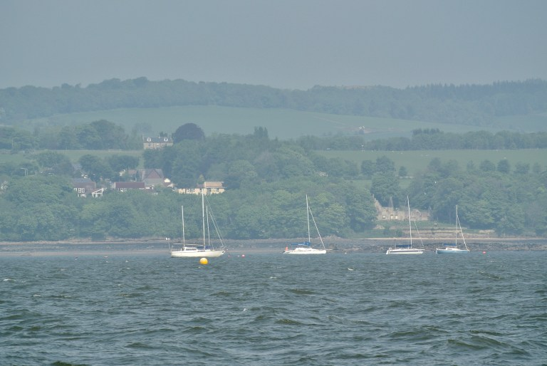 Four sailboats in the Firth of Forth.