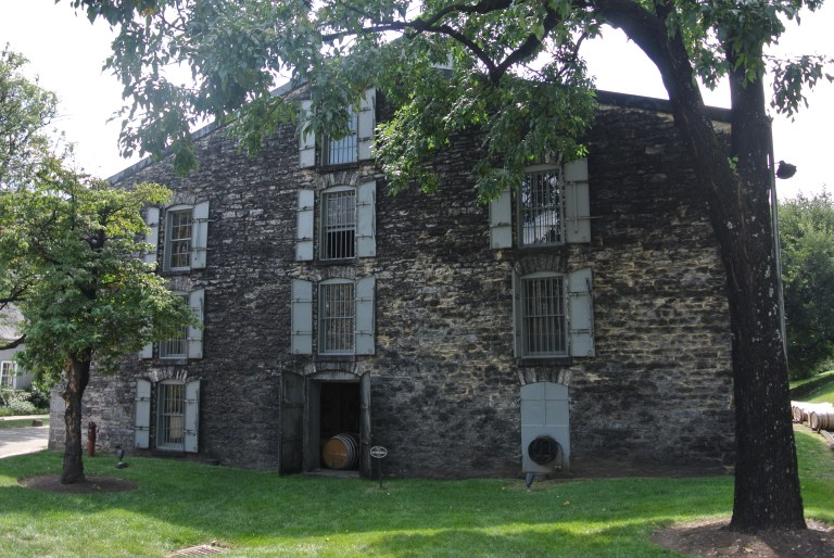 A stone building housing whiskey barrels.