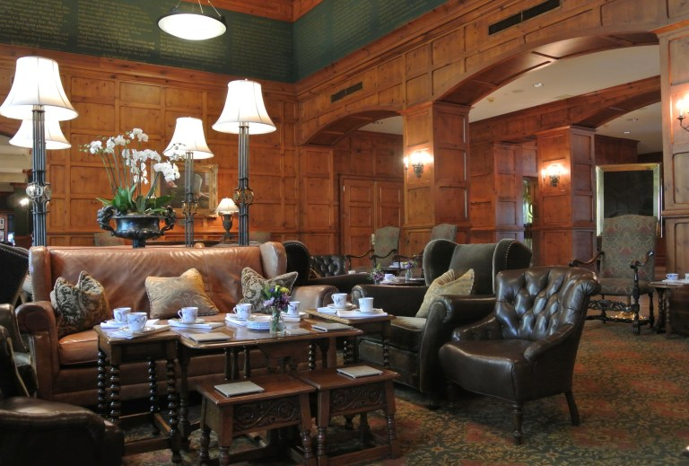 A wood paneled room with a sitting area at the O'Henry Hotel.