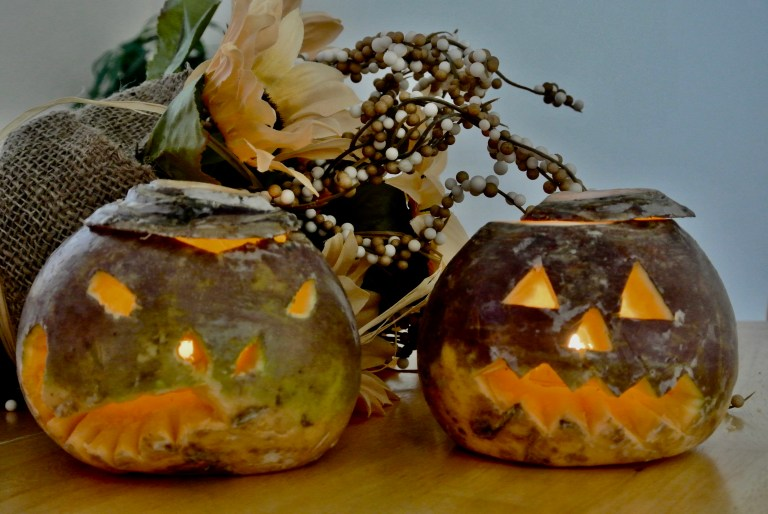 Two carved turnips lit by candles.