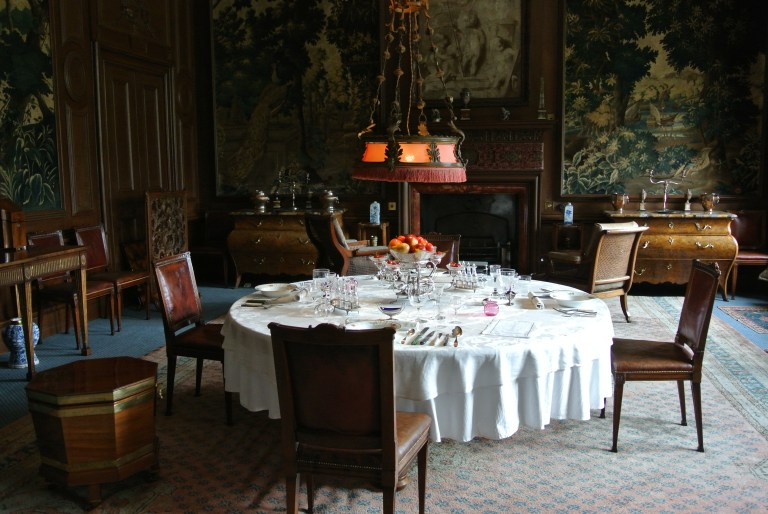A large circular table in the dining room at Lauriston Castle.