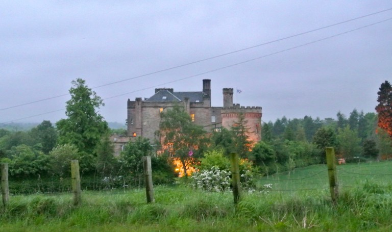 A view of Dalhousie Castle lit up at night.