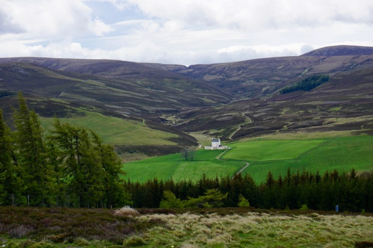 Corgarff Castle looking very tiny against the Scottish Highland countryside.