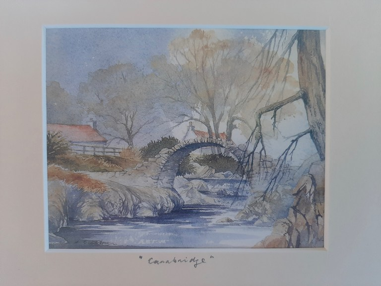 A watercolor of Old Packhorse Bridge.