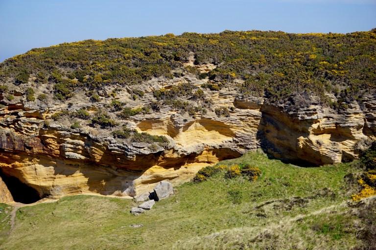 Rocky sea cliff at Cove Bay.