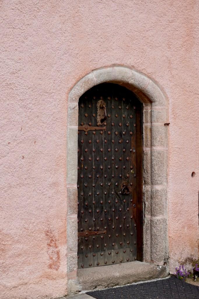 The brown medieval door at Craigievar Castle.
