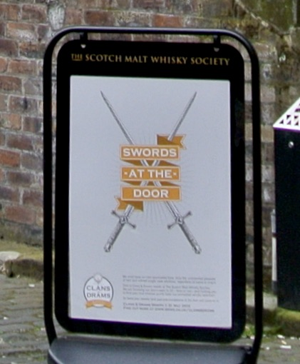 A sign that says Swords at the Door.