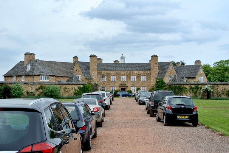 The car lined driveway up to Greywalls Hotel.