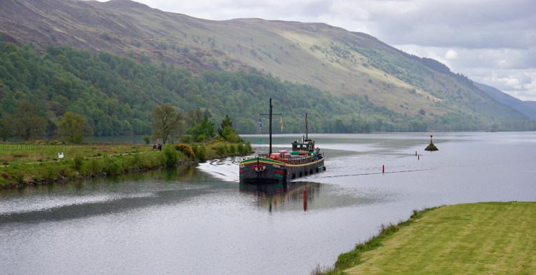 A barge called the Fingal of Caledonia sailing on the Caledonian Canal