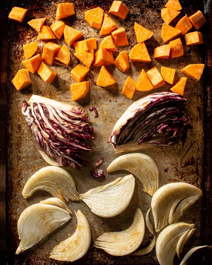 prepared sweet potoates radicchio and onions on tray