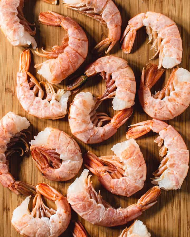 Raw Argentine shrimp on wood board