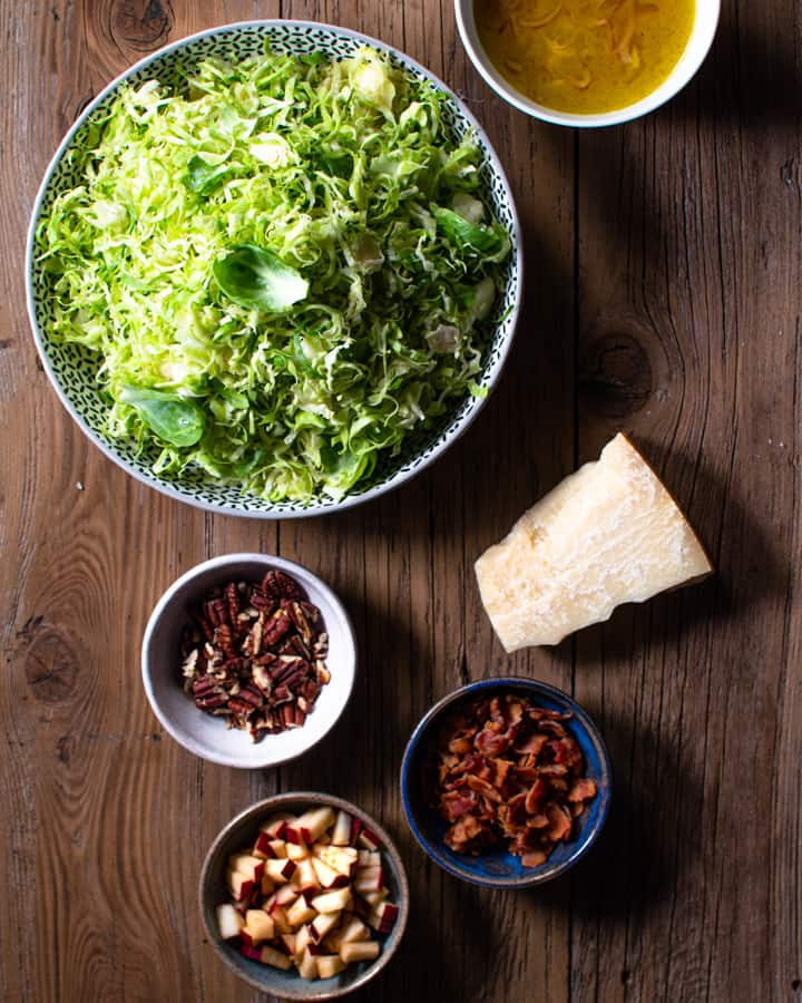 Ingredients for slaw in separate bowls