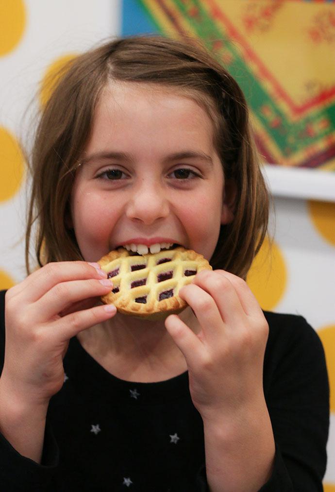 Girl eating jam tart - mypoppet.com.au
