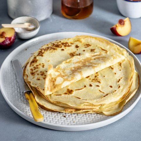 crepe recipe - stack of crepes on a plate