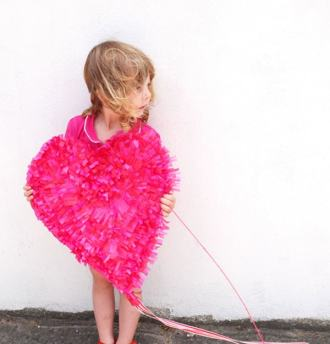 girl holding pink heart paper valentine kite DIY