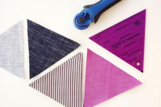Rotary cutter and fabric triangles patchwork quiltalong