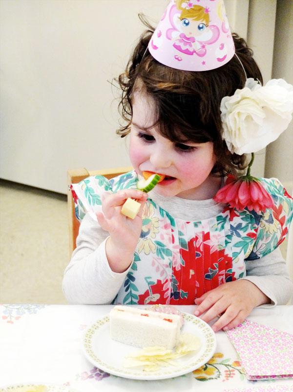 girl eating veggie flowers