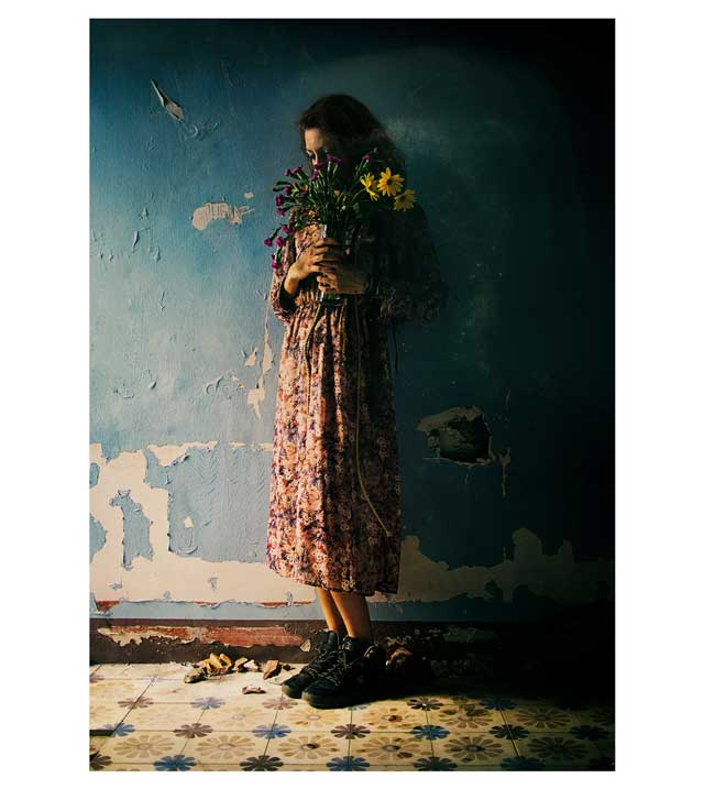 Girl indoor Portrait with Flowers