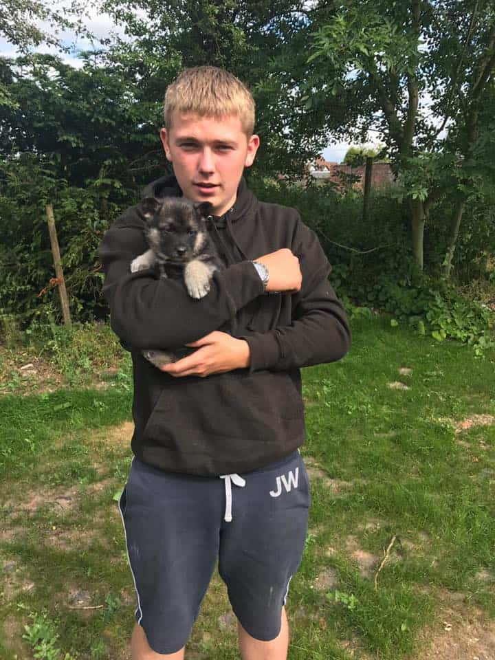 Jon Horne holding a puppy