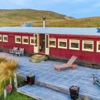 Couple build their own stunning off grid home from old way railway carriage