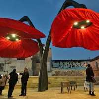 These giant urban flowers bloom when pedestrians walk under them