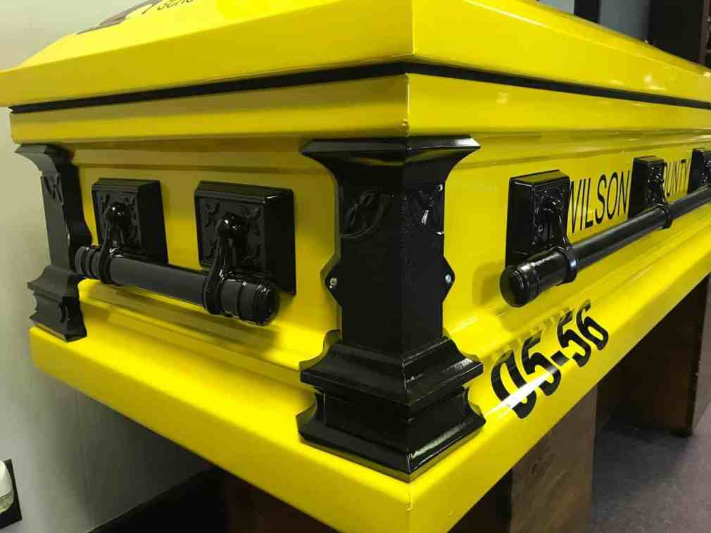 laid to rest in a school bus themed casket