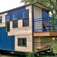 The rooftop deck and spacious living room in this home defy what you might think of a 'tiny house'