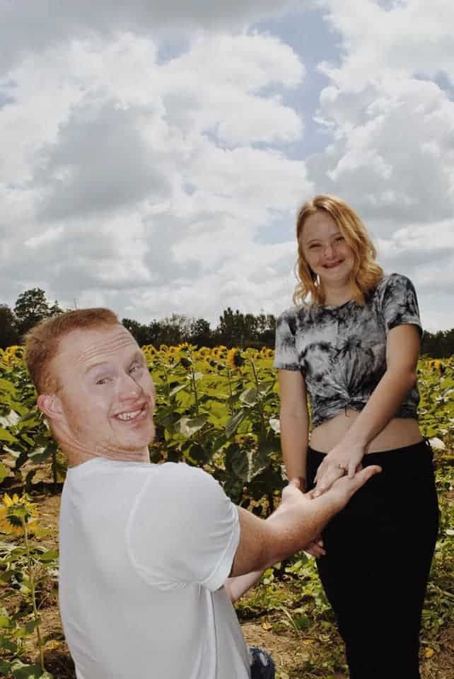 Couple engagement in sunflower field