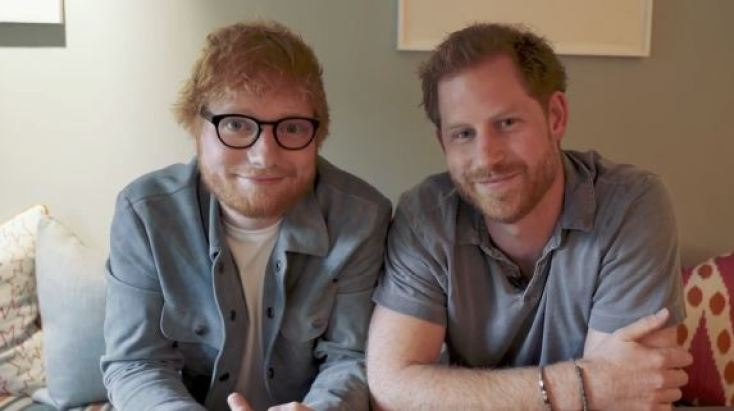 Prince Harry and Ed Sheeran smiling