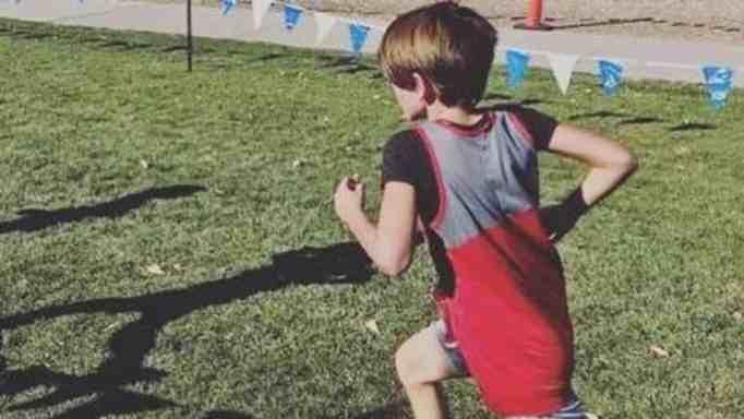 Young boy wins 10K race.