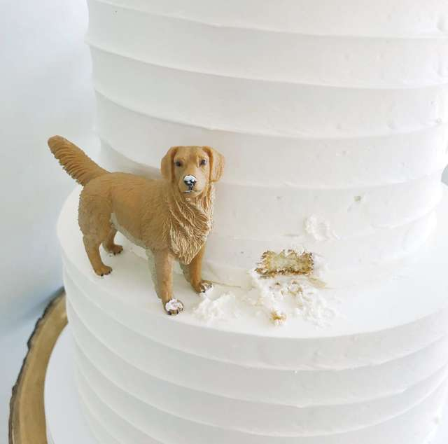 A dog figurine in a wedding cake
